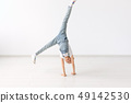 people, sport and children concept - pretty little girl doing gymnastics over white background 49142530