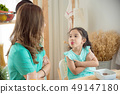 Little girl refuse to have breakfast with her mom 49147180