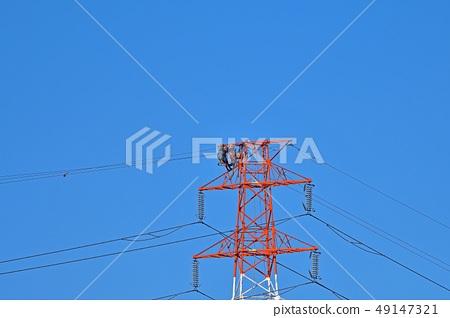 철탑에서 작업하는 사람들 49147321