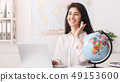 Tour agent with headset consulting client online 49153600