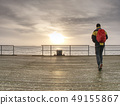 Traveler with back pack at ferry port, pier in 49155867