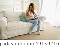 young mother breastfeeding her little son 49159216