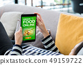 Order food online concpet.Woman lying down on sofa 49159722