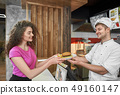 Chef giving girl plate with delicious hamburger. 49160147