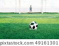 Soccer goalkeeper on the field. Young boy as a football goalkeeper. 49161301