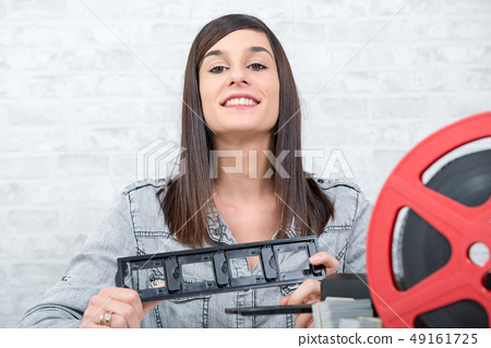 pretty young woman technician scanning film slide 49161725