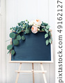 Empty wedding chalkboard sign mockup scene. Floral garland of eucalyptus branches and apricot 49162127