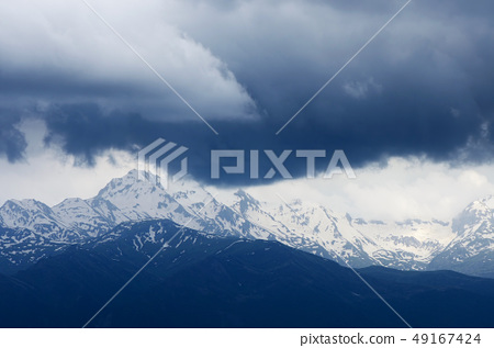 Mountains in the clouds 49167424