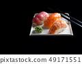 Macro shot of sashimi, uramaki and nighiri, Japanese dish consisting of rice, salmon or tuna, shrimp 49171551