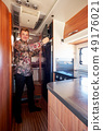 Male standing in the kitchen in motor home 49176021