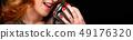 Beautiful redhead woman singing 49176320