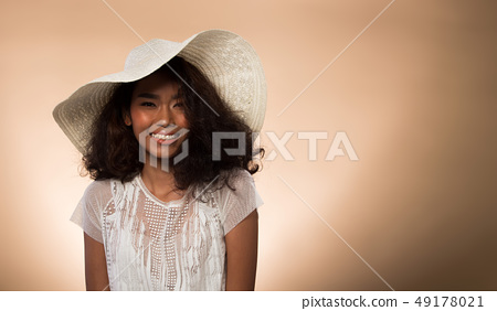 Fashion Asian Woman Tan skin black hair eyes 49178021