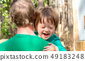 Happy toddler boy being held 49183248
