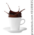 Splash of chocolate in white cup with saucer 49189835