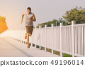 young people runner running on running road  49196014