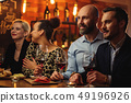 Group of friends having fun talk behind bar counter in a cafe 49196926