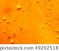Scores of yellow bubbles on orange background 49202518
