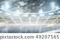 Ice hockey arena. Outdoor winter stadium. Night rink. Snowfall at the stadium 49207565