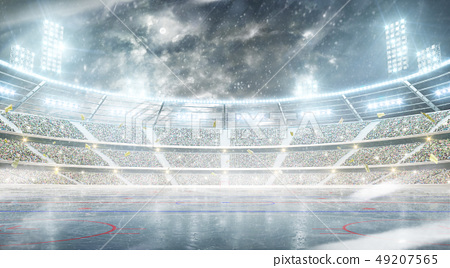 Ice hockey arena. Outdoor winter stadium. Night rink. Snowfall at the stadium 49207565