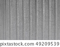 Texture for background metal profiled fence. A corrugated fence of grey metal sheets 49209539