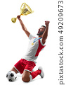Professional soccer player celebrates winning. Soccer celebration. Medal on the neck. Isolated on 49209673