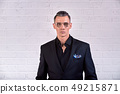 Portrait of a elegant handsome business man on white background 49215871