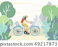 Girl riding a bike with a tourist backpack in the mountains 49217873