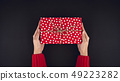 Woman hands giving christsmas gift box top view on 49223282