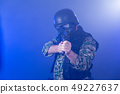 Soldier holding assault rifle in smoky haze 49227637