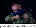 Soldier holding assault rifle 49227672
