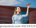 young businesswoman with toy wooden plane  49239329
