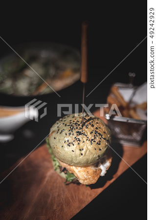 Burger with Fries on Wooden Plate 49242929