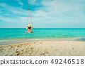 Woman swing the swings a t the beach on summer. 49246518