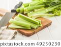 Celery sticks. Cutting celery stalks. 49250230