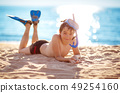 Child lying on the beach with swimming mask 49254160