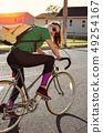 Girl riding a vintage bicycle 49254167