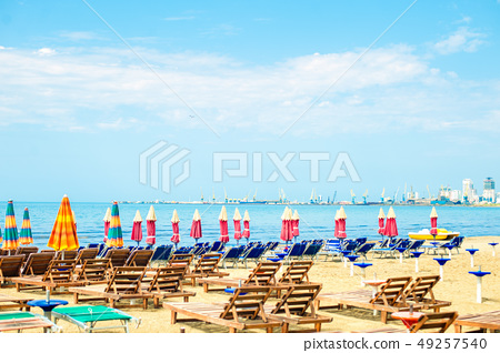Aerial view to sandy beach of Adriatic sea in Albania, full of umbrellas and sunbeds 49257540