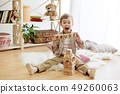 Wooden cubes with word ABUSE in hands of little boy 49260063