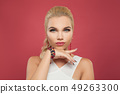 Elegant woman in gold earrings and bracelet 49263300