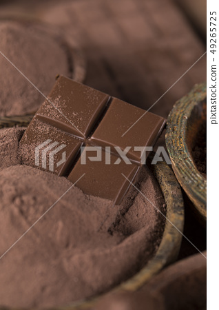 Cocoa beans and chocolate on natural paper 49265725