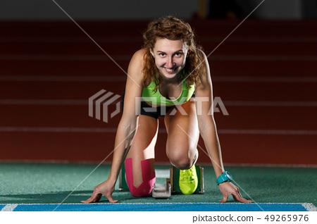 Female athlete on the start at sprint running 49265976
