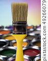 Paint brush, tin can and color guide samples 49266079