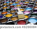 Tin cans with paint and brushes 49266084
