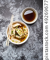 Asian dumplings in bowl 49269677