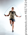Man jumping with skipping rope during the training 49271614