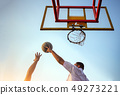 player block action ball in basketball game 49273221