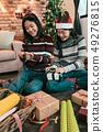 girl cutting green ribbon handmade presents 49276815