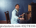 Brutal Man With a Beard 40 Years Old Plays the Old Piano. 49278396