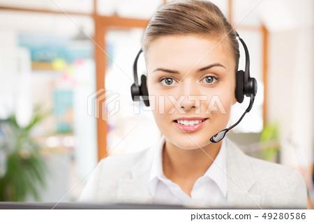 helpline operator in headset working at office 49280586