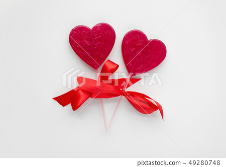 red heart shaped lollipops for valentines day 49280748